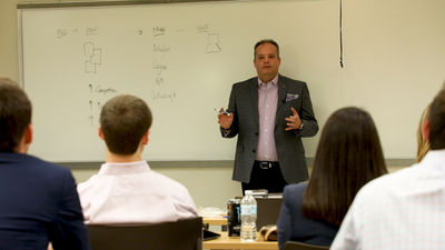 Simon presenting the history of Anaplan during a recent University visit.