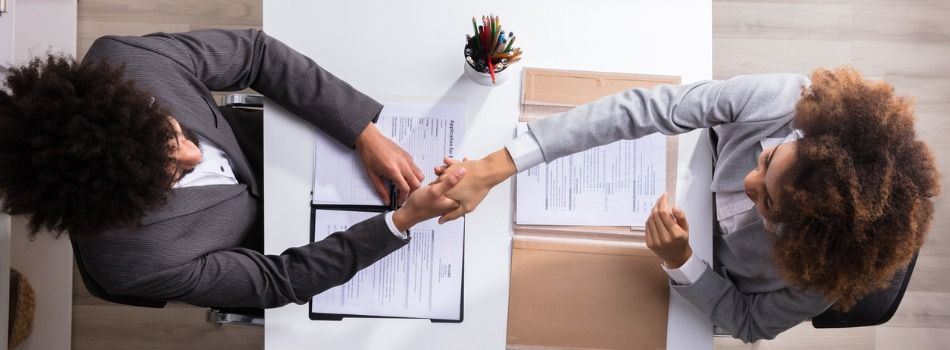 male-manager-shaking-hands-with-female-applicant-picture-id949182974.jpg
