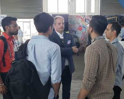 Simon Tucker talks with students at CPX.