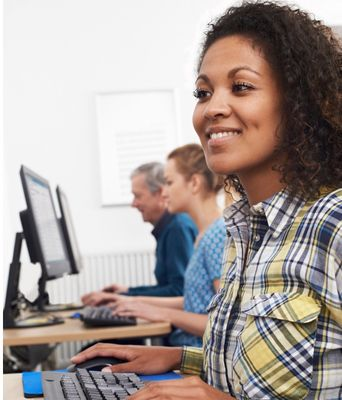 young-woman-attending-computer-class-picture-id941862400.jpg