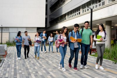 young-latin-american-students-leaving-the-university-campus-after-a-picture-id1165150779.jpg