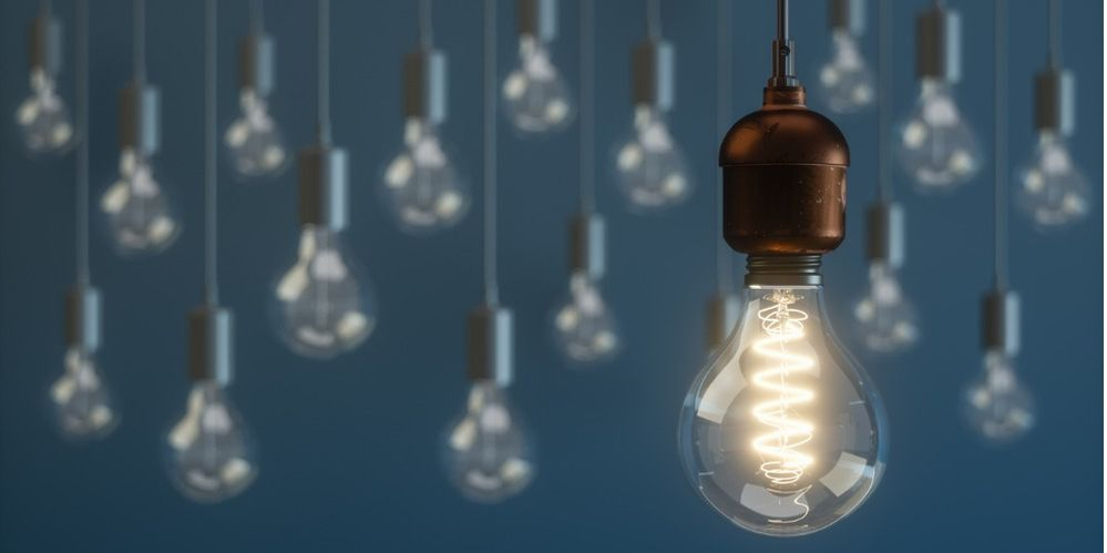 light-bulb-standing-out-from-the-crowd-concepts-picture-id1126360714 (1).jpg