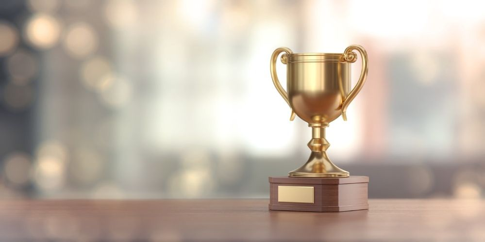 gold-award-cup-against-defocused-background-picture-id912720150 (1).jpg