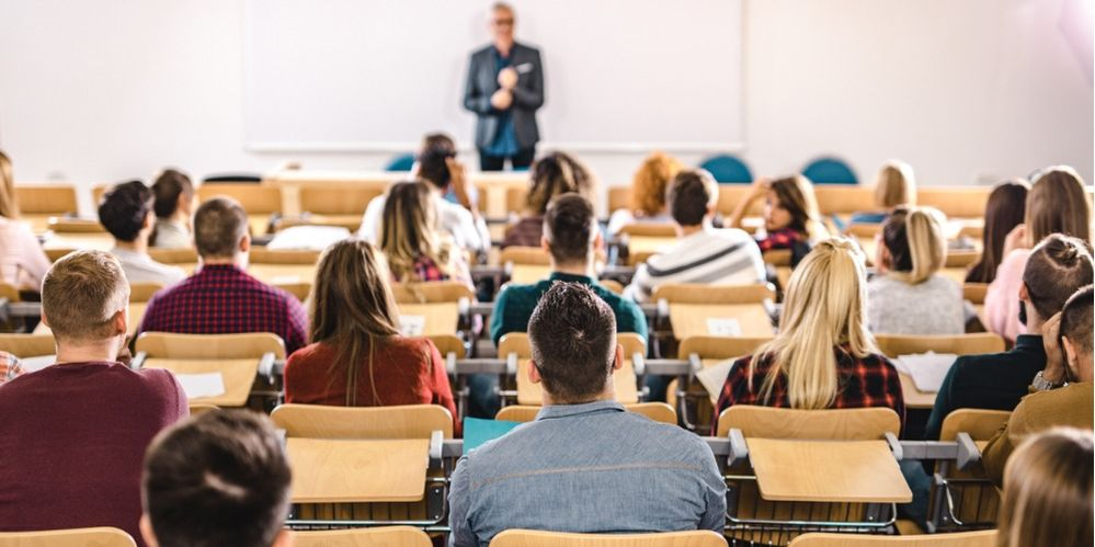 rear-view-of-large-group-of-students-on-a-class-at-lecture-hall-picture-id1138138146.jpg