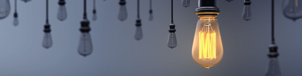 glowing-light-bulb-standing-out-from-the-crowd-picture-id1036100456.jpg