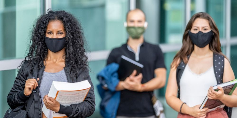 mixed-ethnicity-students-wearing-masks-on-campus-picture-id1256757902 (2).jpg